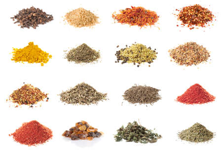 Set of spices heaps isolated on white background photo