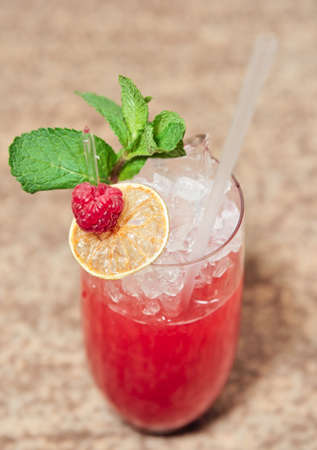 Raspberry cocktail with mint in highball glass photo