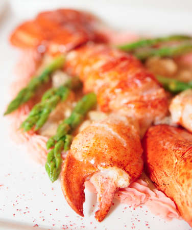 lobster tail: Prepared bretagne lobster on a porcelain plate Stock Photo