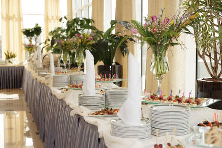 wedding table setting: Table with dishware and tasty food waiting for guests