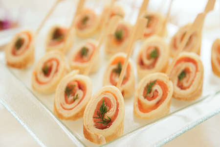 tapas: Rolled pancakes with smoked salmon, selective focus Stock Photo