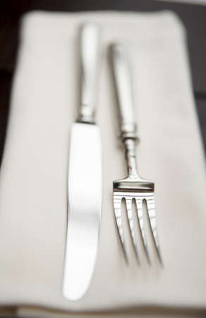 Fork, knife and napkin, very shallow focus photo
