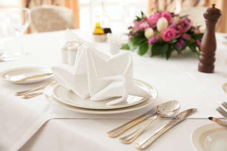 Table arrangement in an expensive haute cuisine restaurant photo