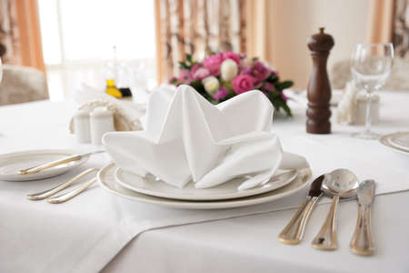 Place setting in an expensive haute cuisine restaurant photo