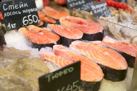 Salmon steaks on cooled market display, close-up shot  photo