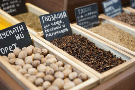 Cloves, nutmeg and another spices on street market, selective focus