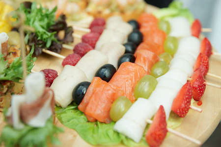 fruit platter: Salmon canapes on restaurant table, narrow focus depth Stock Photo