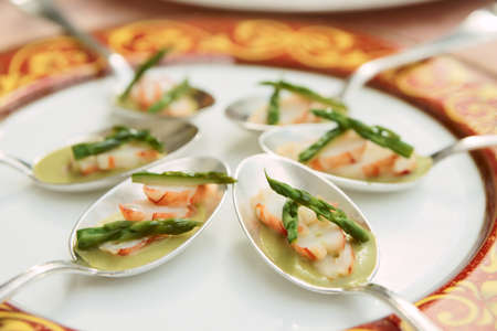 Banquet dish with crab and asparagus photo
