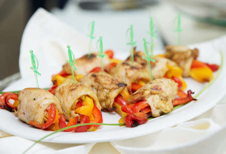 Chicken rolls with bell pepper on porcelain plate Stock Photo