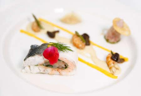 Haute cuisine stylish dish with stuffed seabass photo