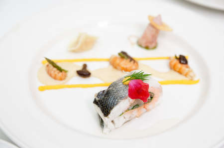 fine fish: Seabass haute cuisine dish, shallow focus depth Stock Photo