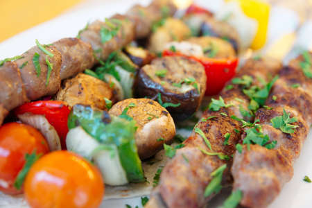 Grilled chicken hearts and vegetables on the metal skewers Stock Photo