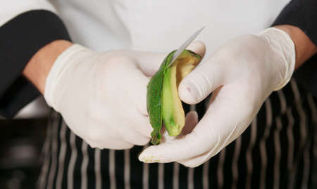 Chef is peeling avocado to make an appetizer  Stock Photo