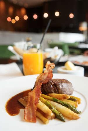 Fine tenderloin steak with asparagus, celery and grilled bacon crisp