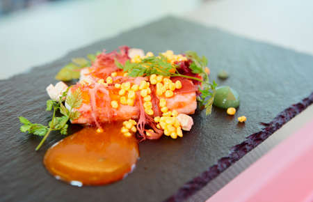 gastronomy: Chili crab cooked in modern way with molecular egg yolk caviar Stock Photo