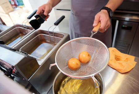 Chef cooking dim sum in a deep fryer - asian takeout food Stock Photo - 10025120