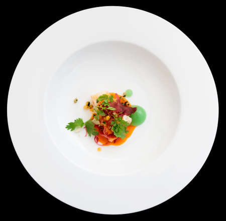 Chili crab cooked in modern way in plate isolated on black background photo