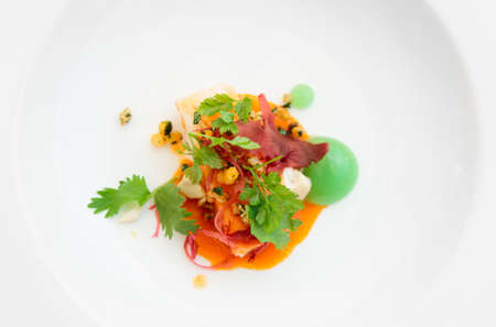 Chili crab cooked in modern way with molecular egg yolk caviar photo