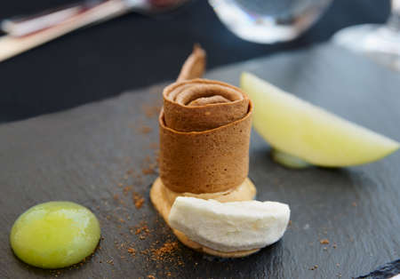 haute: Foie gras served in modern asian style with green apple and ginger crunch on stone plate