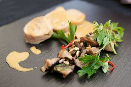 Chicken fillet cooked in asian way with shiitake black mushrooms