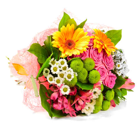 Bright bouquet lying on a white surface photo