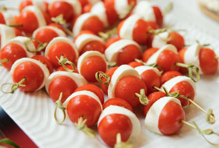 food buffet: Canapes of  mozarella cheese and cherry tomatos  Stock Photo