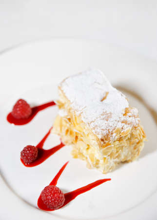 cream puff: Piece of mille-feuille cake on porcelain plate Stock Photo
