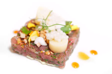 tuna salad: Elegant tuna tartare with flower petals and delicious sauce