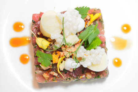 tartar: Elegant tuna tartare with flower petals and delicious sauce
