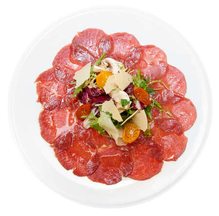 ruccola: Carpaccio of beef, mushrooms, ruccola and cheese isolated on white background