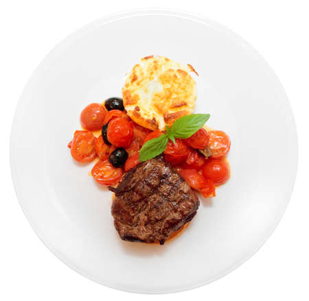 Tasty tenderloin steak with vegetables isolated on white background