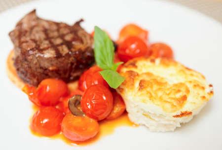 Tasty tenderloin steak with vegetables on plate photo