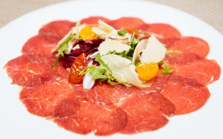 fine dining: Carpaccio of beef, mushrooms, ruccola and cheese