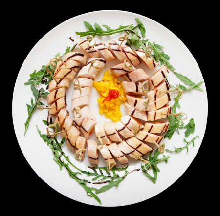 Plate with appetizer, isolated on black background photo