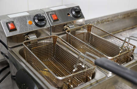 deep fry: Deep fryer with oil on restaurant kitchen