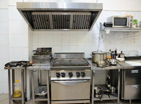stainless steel kitchen: Typical kitchen of a restaurant shot in operation