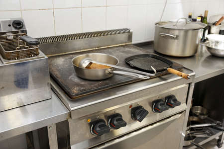 stainless steel range: Typical kitchen of a restaurant shot in operation Stock Photo