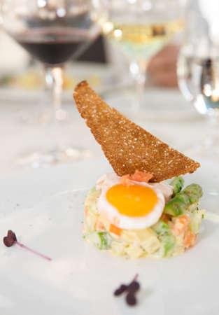 Haute cuisine appetizer on restaurant table photo