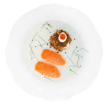 Salmon fillet with bread and caviar in plate isolated on white with clipping path photo