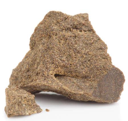 Substance looking exactly like hashish, isolated photo