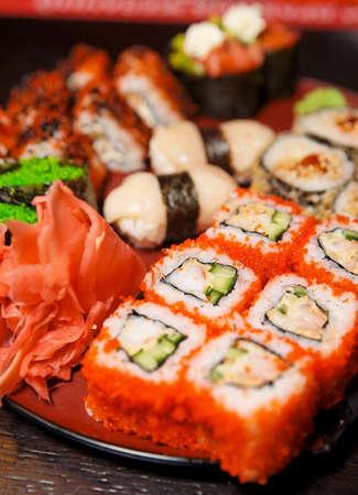 japanese culture: Maki sushi on black plate, close-up