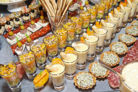 canapes: Snacks and sweets on the banquet table