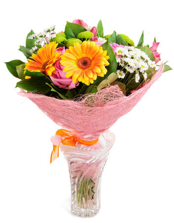 Bright bouquet in crystal vase isolated on white background photo
