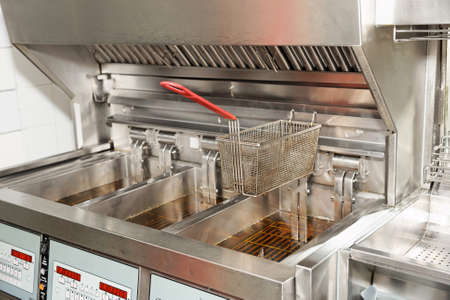 Deep fryer with  oil on restaurant kitchen photo