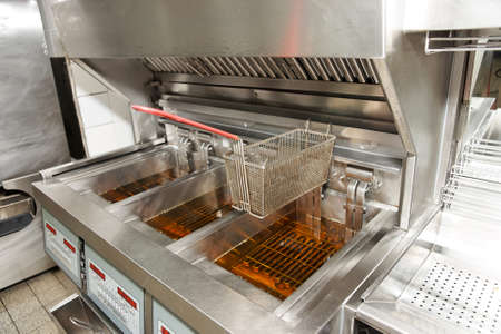 clean commercial: Deep fryer with oil on restaurant kitchen