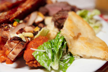 Plate with assortment of foods close-up photo