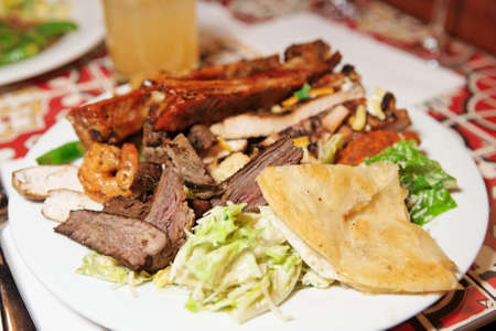 Big plate with assortment of foods - for really hungry guys photo