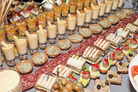 Snacks and sweets on the banquet table photo
