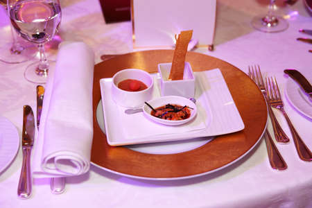 Place setting in a restaurant with small elegant snack photo