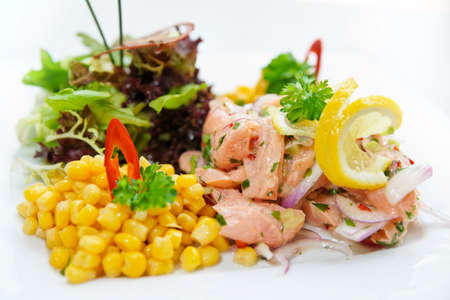 american cuisine: Salmon ceviche with corn and herbs close-up